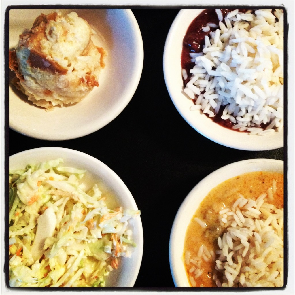 Papa's unlimited sides. Clockwise from the top-left: Bread pudding, Red beans and rice, Mushroom etouffee and slaw