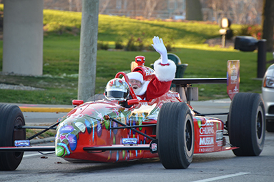 Santa arrives Dallara IndyCar Style at the Children's Museum of Indianapolis November 29th